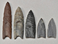 a collection of Clovis point replicas and casts in the archaeology lab