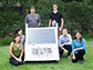 Rice University researchers with a scaled up test bed of the NEWT Center's direct solar desalination system