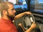 Nate Medeiros-Ward operates a driving simulator
