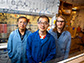 Niankai Fu, left, Song Lin and Greg Sauer take a short break in the laboratory