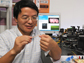 Huikai Xie displays a micro-endoscope