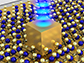 single gold nanocube sits on top of an atom-thin material