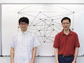 researchers in front of a white board