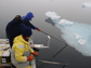 researchers pushing ice-floes away