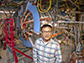 Jongsoo Yoo stands next to the Magnetic Reconnection Experiment