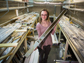 Elizabeth Thomas holds half of a sediment core