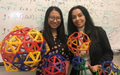 Siyu Li (left) and Roya Zandi holding various icosahedral structures