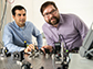 Alireza Marandi, left, and Marc Jankowski prepare to carry out experiments at the optical bench