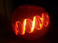 a lit up carved pumpkin
