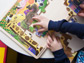 image of a child putting together a puzzle
