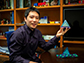 Ou Chen holds a mock-up of the tetrahedral quantum dot building blocks