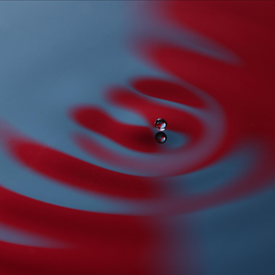 image of a drop touching a liquid surface