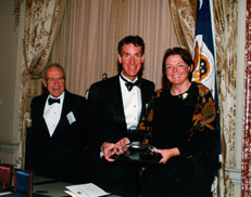 Accepting the Award, Bill Nye, Host/Head Writer, and  Elizabeth Brock, Executive Producer. Also shown in the photo, David Perlman, Chair, NSB Public Service Award  Advisory Committee