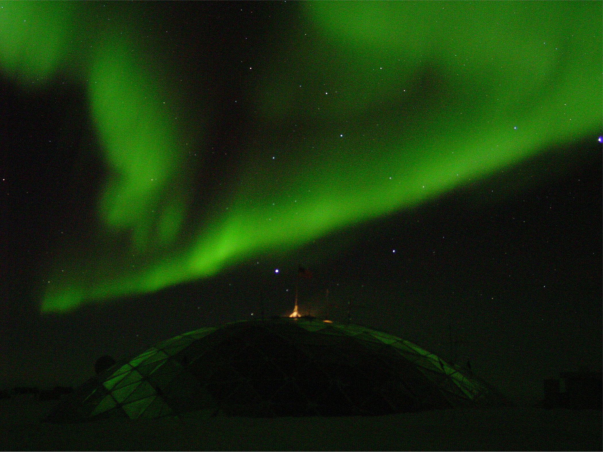 the Southern Lights, over the geodesic dome at NSF's Amundsen-Scott South Pole Station; caption is below